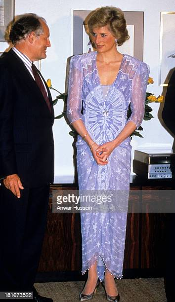Princess Diana Princess of Wales wearing a purple Zandra Rhodes cocktail dress attend a reception at the British Consulate in Dubai on March 01 1989...