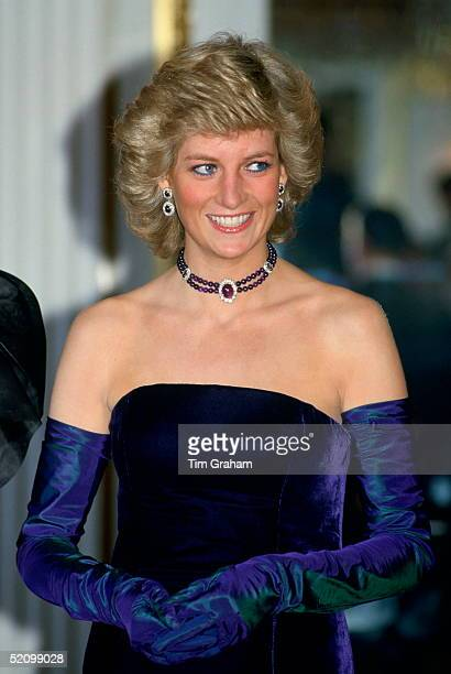 Diana, Princess Of Wales, Wearing A Purple Velvet Sleeveless Evening Dress Designed By Catherine Walker With Matching Choker And Earrings For A...