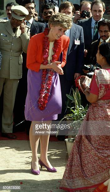 Diana Princess of Wales wears a Catherine Walker suit and a garland during a visit to the Marie Stopes Clinic on February 11 1992 in Agra India