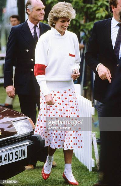 Princess Diana Princess of Wales wearing a Mondi white skirt with red polka dots with matching ankle socks at a polo match in Windsor in June 1986