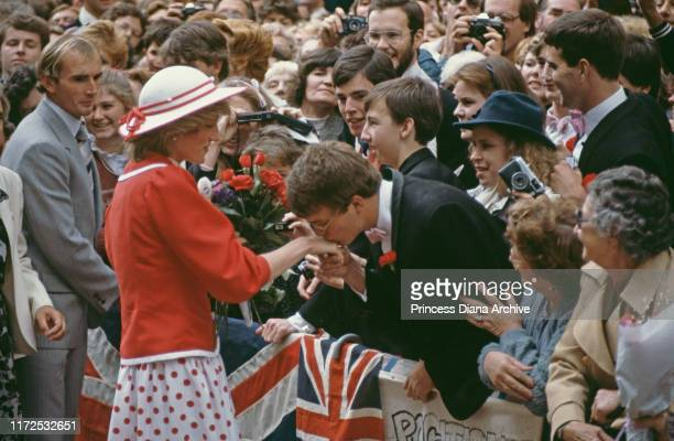 Diana, Princess of Wales wearing a red and white spotted suit by Catherine Walker during a visit to Bourke Street Mall in Melbourne, Australia, 14th...
