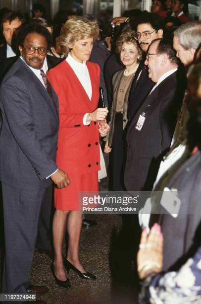 Diana, Princess of Wales wearing a red and white suit by Catherine Walker during a visit to the AIDS unit of Harlem Hospital, New York City, USA,...
