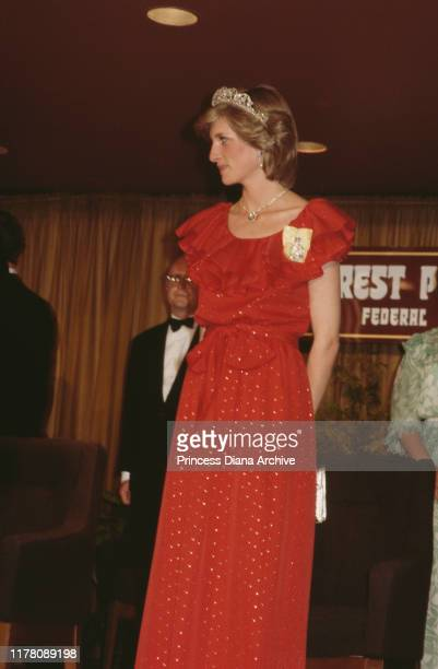 Diana, Princess of Wales wearing a red Bruce Oldfield gown to a state reception in Hobart, Tasmania, 30th March 1983. She is wearing the Spencer...