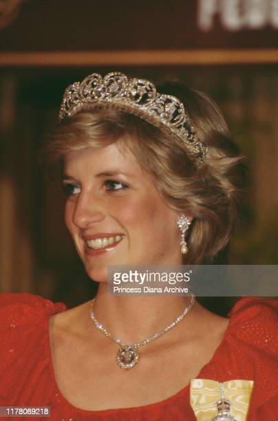 Diana Princess of Wales wearing a red Bruce Oldfield gown to a state reception in Hobart Tasmania 30th March 1983 She is wearing the Spencer family...