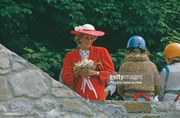 Diana, Princess of Wales wearing a red coat by Jan Van Velden during a visit to Atlantic College in Llantwit Major, Wales, June 1985.