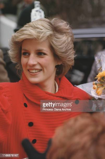 Diana, Princess of Wales wearing a red coat in Basingstoke, England, May 1986.