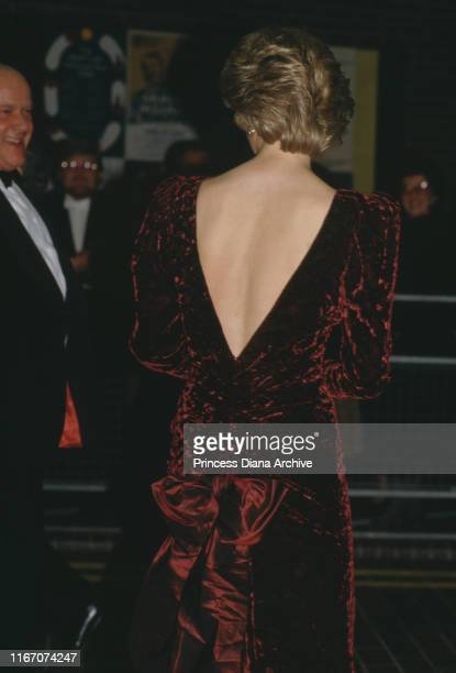 Diana Princess of Wales wearing a red crushed velvet evening gown by Catherine Walker to an event at the Barbican Centre in London November 1985