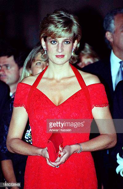 Diana Princess of Wales wearing a red dress designed by Catherine Walker attends a dinner in her honour on November 24 1995 in Argentina