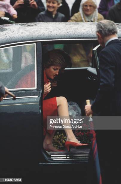 Diana Princess of Wales wearing a red suit by Catherine Walker during a visit to Winchester England May 1988
