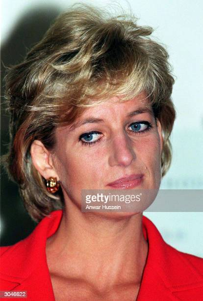This undated photo shows Diana Princess of Wales listening to speeches at the London Lighthouse Diana told of a lonely existence in her married life...