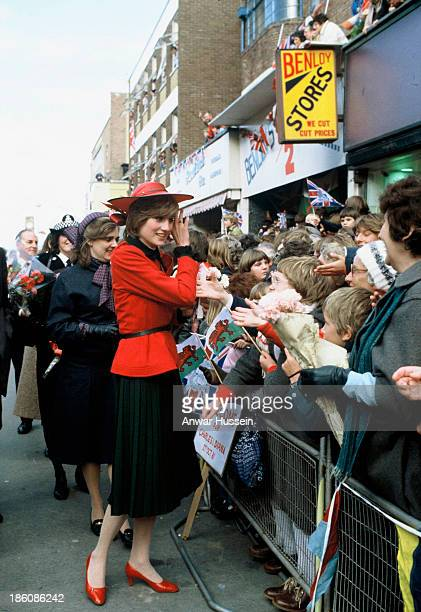Princess Diana Princess of Wales wearing a red Donald Campbell suit and John Boyd hat meets the public during her first official visit to Wales on...