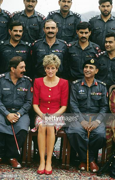 Diana Princess of Wales poses with soldiers during her visit tothe Khybar Pass Pakistan in October 1991