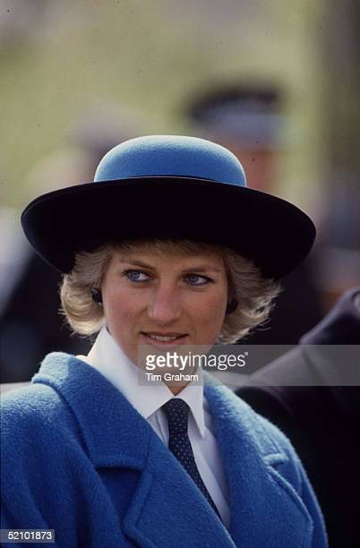 Diana Princess Of Wales Wearing A Shirt And Tie Underneath A Blue Coat Which She Has Teamed With A Blue And Black Hat