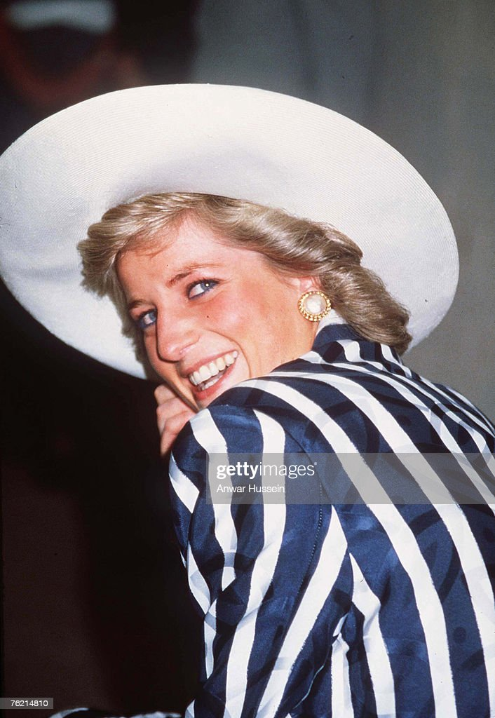 Princess Diana, Princess of Wales, wearing a navy and white Klein suit, smiles while visiting Australia.