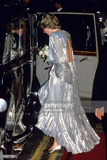 Diana Princess of Wales wearing a Bruce Oldfield silver gown attends the film premiere of the James Bond film 'A View to a Kill' at the Empire...
