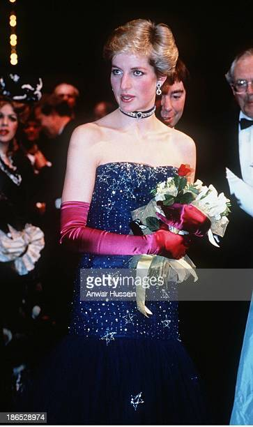 Diana Princess of Wales wearing a navy blue Murray Arbeid dress and shocking pink long gloves attends 'Phantom of the Opera' on February 01 1987 in...