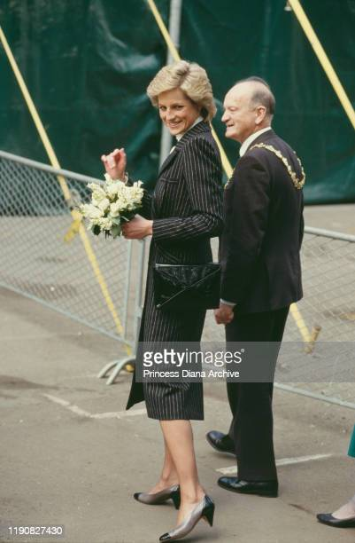 Diana, Princess of Wales wearing a striped coat-dress by Catherine Walker during a visit to Battersea Park in London to see the Moscow State Circus,...