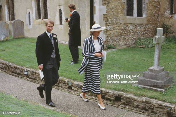 Diana Princess of Wales wearing a suit by Roland Klein to the wedding of Sarah Brennan and Hugh Lyndsay at Compton Church England July 1987 She is...