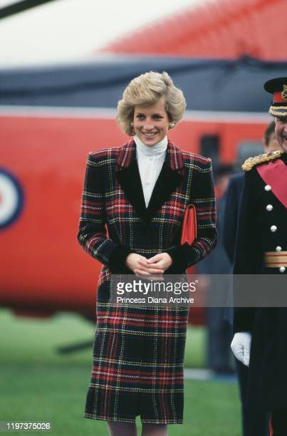 Diana, Princess of Wales wearing a tartan coat-dress by Catherine Walker as she arrives by Royal Flight in Alton, Hampshire, UK, January 1989.