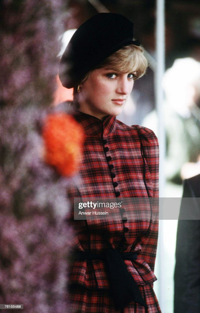 Diana, Princess of Wales, wears a tartan outfit by Caroline Charles when she attends the Braemar Games in September 1981.