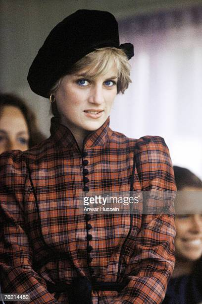 Diana, Princess of Wales, wearing a tartan dress designed by Caroline Charles and a black Tam o' shanter style hat, attends the Braemar Highland...