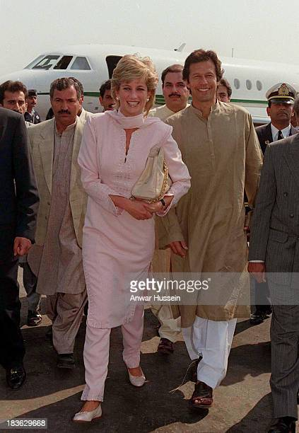 Diana, Princess of Wales, wearing a traditional pink shalwar kameez, is welcomed at Lahore airport by Imran Khan on February 20, 1996 in Lahore,...
