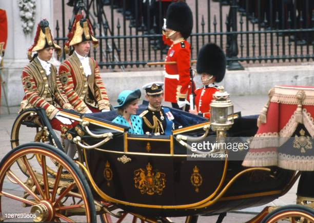 Diana, Princess of Wales, wearing a turquoise dress with black polka dots and a matching hat, and Prince Charles, Prince of Wales ride in an open...