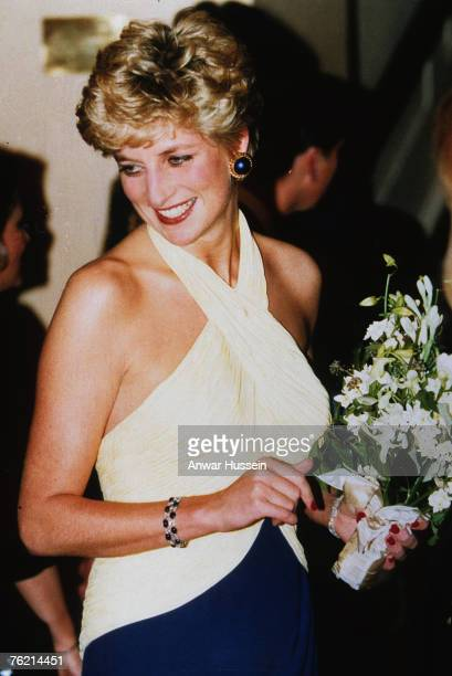 Diana, Princess of Wales, wearing a two tone halter neck dress, backstage at the Royal Opera House in Covent Garden for the production of Verdi's...