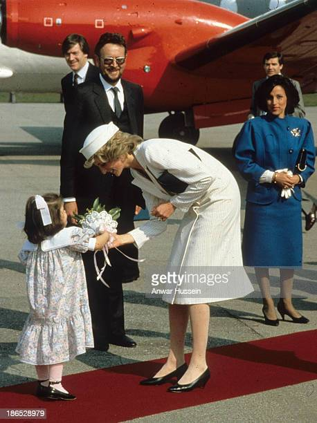 Diana Princess of Wales wearing a white Catherine Walker dress and Join Boyd hat arrives in La Spezia on April 20 1985 in La Spezia Italy