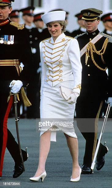Diana Princess of Wales wears a Catherine Walker white suit with drum majorette gold frogging and epaulettes and a graham smith hat for her visit to...
