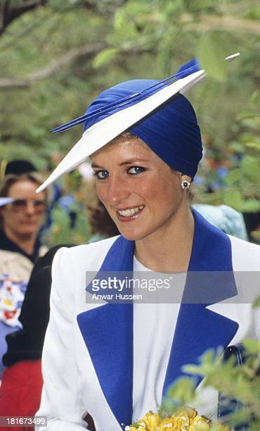 Diana Princess of Wales wears a Catherine Walker blue and white outfit and a Philip Somerville turban hat during an official visit to Dubai on March...