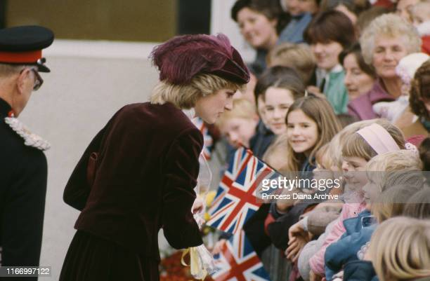 Diana Princess of Wales wearing a winecoloured velvet suit by Jaeger and a John Boyd hat during a visit to St Austell in Cornwall November 1983