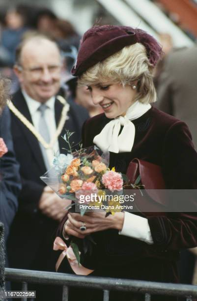 Diana, Princess of Wales wearing a wine-coloured velvet suit by Jaeger and a John Boyd hat during a visit to St Austell in Cornwall, November 1983.