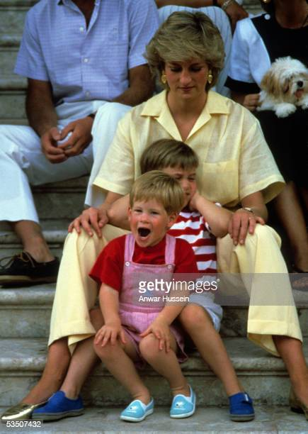 Princess Diana Princess of Wales with Prince William and Prince Harry on holiday in Majorca Spain on August 10 1987 Also present were the Spanish...