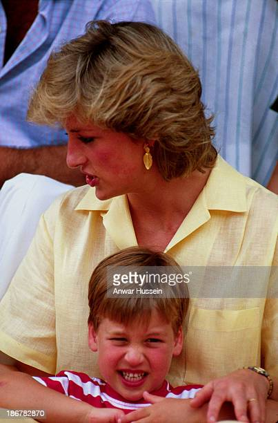 Diana Princess of Wales poses with Prince William during a summer holiday in Majorca on August 10 1987 in Palma Spain