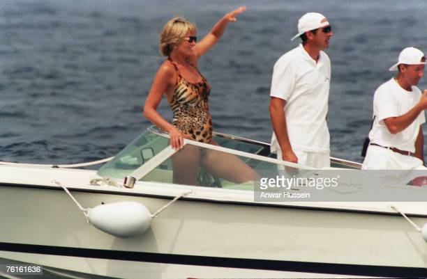 The Princess of Wales, wearing a swimsuit, has fun in a boat off the coast of the South of France in July, 1997.