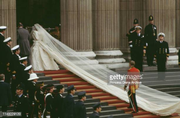 Diana, Princess of Wales , wearing an Emanuel wedding dress, enters St Paul's Cathedral on the hand of her father, Earl Spencer, for her marriage to...