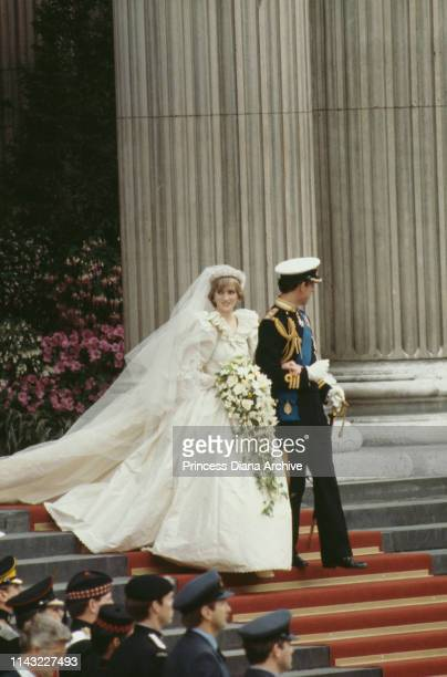 Diana Princess of Wales wearing an Emanuel wedding dress leaves St Paul's Cathedral with Prince Charles Prince of Wales at their wedding London UK...