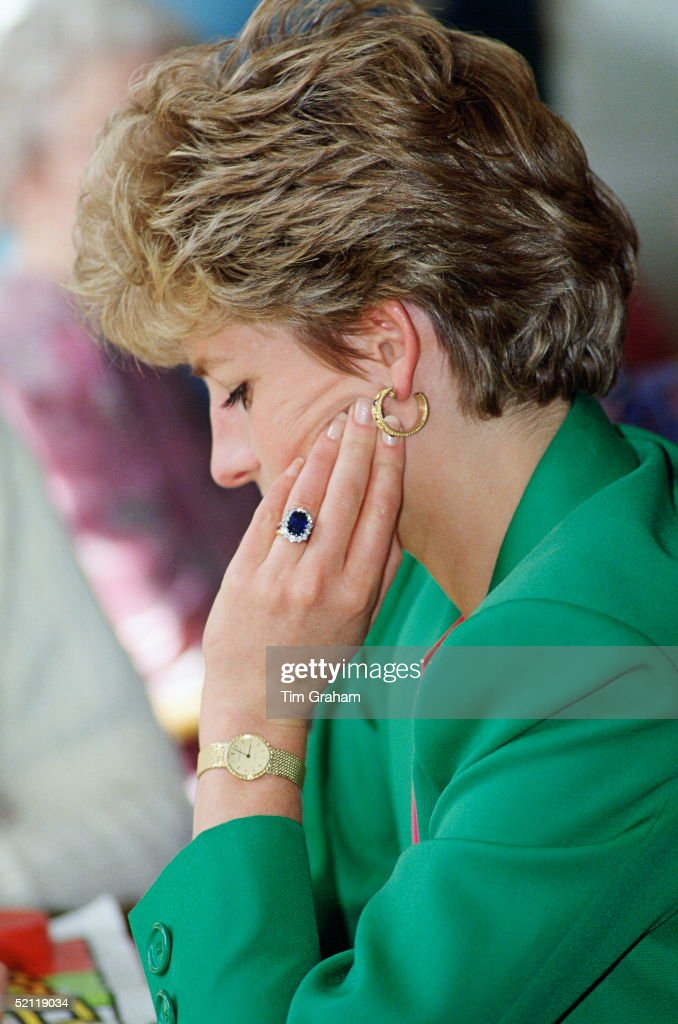 Diana, Princess Of Wales, Wearing Her Diamond And Sapphire Engagement Ring Bought From 'garrards, The Crown Jewellers With A Gold Watch And Gold Earrings