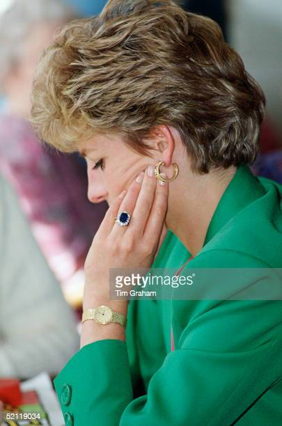 Diana Princess Of Wales Wearing Her Diamond And Sapphire Engagement Ring Bought From 'garrards The Crown Jewellers With A Gold Watch And Gold Earrings