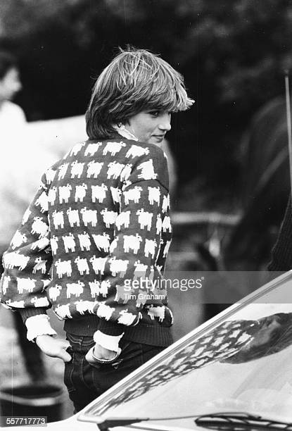 Diana, Princess of Wales, wearing jeans and a sheep print sweater, attending a polo match at Windsor, circa 1985.