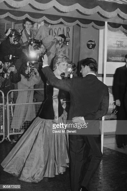 Diana Princess of Wales wearing offtheshoulder flamenco style dress and Charles Prince of Wales at the UK premiere of the film 'Children Of A Lesser...