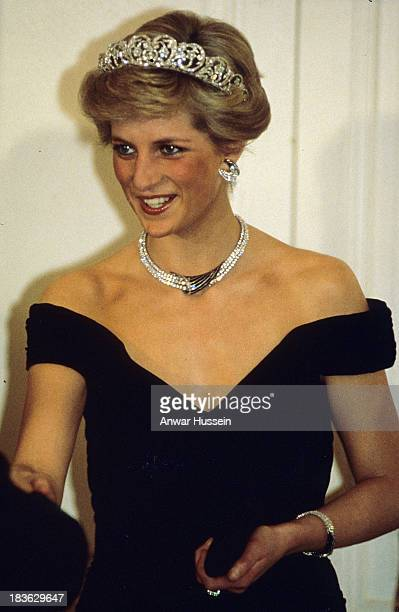 Diana Princess of Wales wearing the Spencer family tiara and crescent shaped diamond and sapphire earring necklace and bracelet given to her by the...