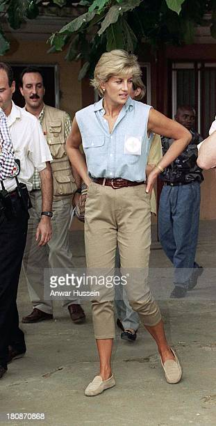 Diana Princess Of Wales wears a British red cross badge as she visits landline victims at Neves Bendinha Orthopaedic Workshop on January 14 1997 in...