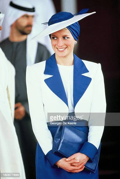 Diana, Princess of Wales, wears a Catherine Walker suit and a Philip Somerville turban hat during her official tour of the Gulf States on March 17,...