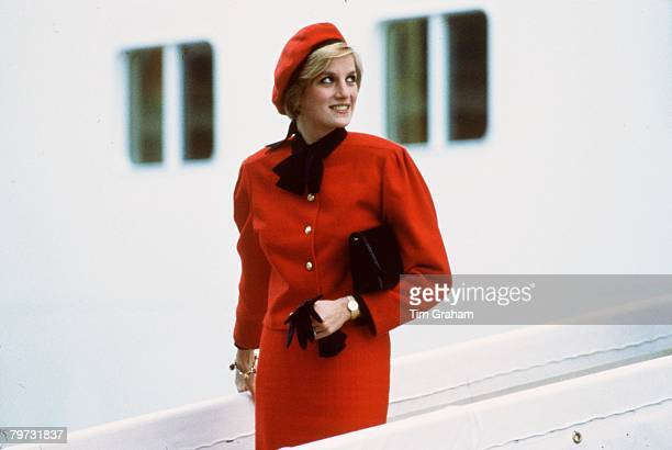 Diana Princess of Wales wears a charm bracelet aboard the new PO cruise liner 'Royal Princess' named in honour of her after giving the ship its name...