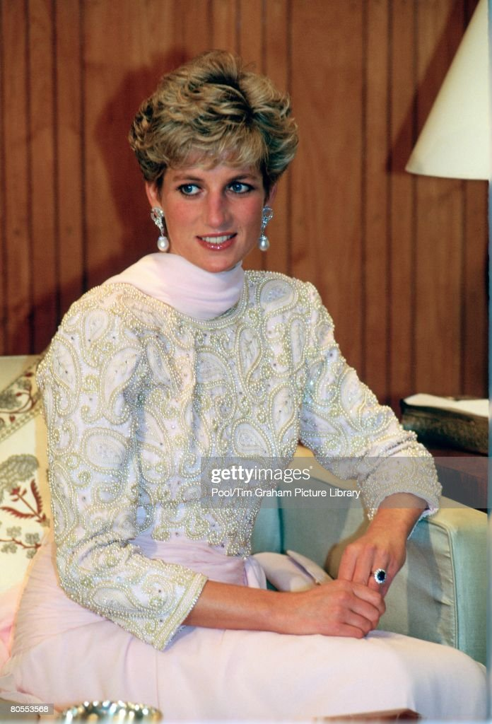 Diana, Princess of Wales wears a dress designed by fashion designer Catherine Walker during a visit to Pakistan