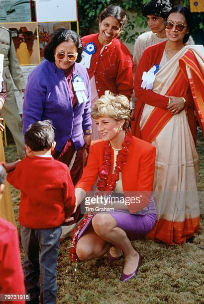 Diana, Princess of Wales wears a garland during her visit to the Marie Stopes Clinic in Agra, India