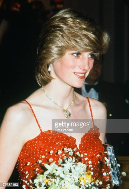 Diana Princess of Wales wears a gold and diamond necklace in the shape of the Prince of Wales feathers for a visit to the Royal Opera House The...