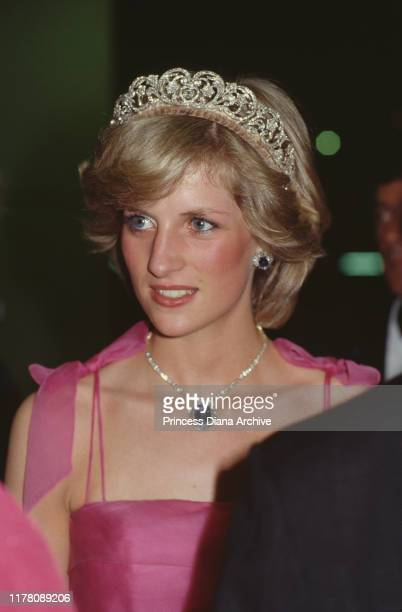 Diana, Princess of Wales wears a pick Victor Edelstein gown and the Spencer family tiara to a state reception in Brisbane, Australia, 11th April 1983.